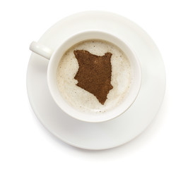 Cup of coffee with foam and powder in the shape of Kenya.(series