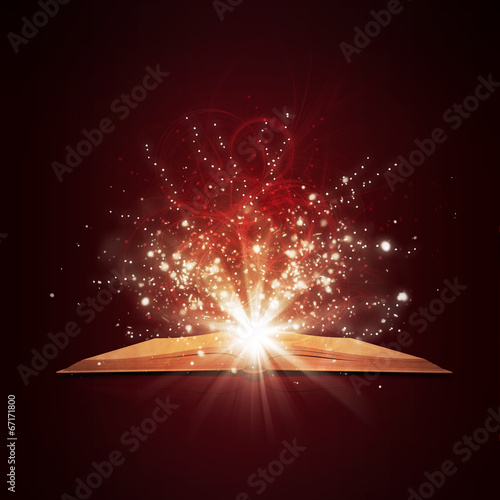 canvas print picture Old open book with magic light and falling stars