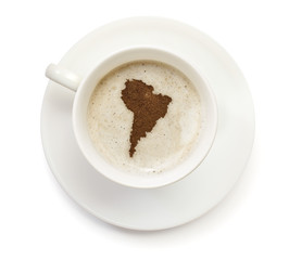 Cup of coffee with foam and powder in the shape of South America
