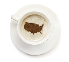 Cup of coffee with foam and powder in the shape of USA.(series)