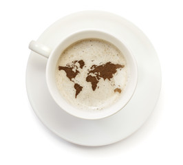 Cup of coffee with foam and powder in the shape of World.(series