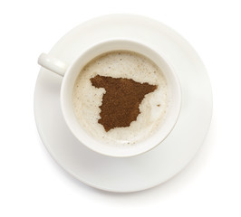 Cup of coffee with foam and powder in the shape of Spain.(series