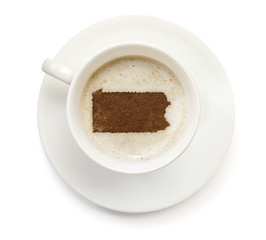 Cup of coffee with foam and powder in the shape of Pennsylvania.