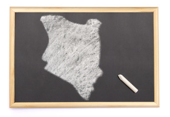 Blackboard with a chalk and the shape of Kenya drawn onto. (seri