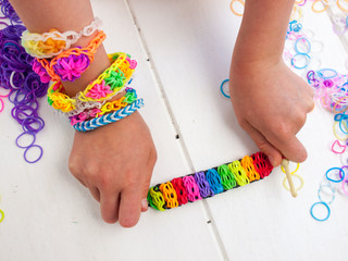 childs hands showing multicoloured bracelet
