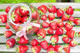 Many ripe strawberry in glass jar. Summer bounty. poster