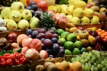 Fruit market with various colorful fresh fruits and vegetables -