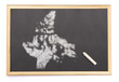 Blackboard with a chalk and the shape of Nunavut drawn onto. (se
