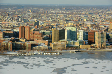 MIT campus on Charles River bank aerial view in winter, Boston