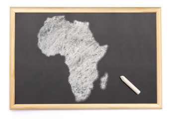 Blackboard with a chalk and the shape of Africa drawn onto. (ser