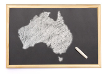 Blackboard with a chalk and the shape of Australia drawn onto. (