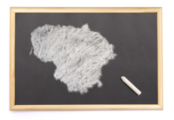 Blackboard with a chalk and the shape of Lithuania drawn onto. (