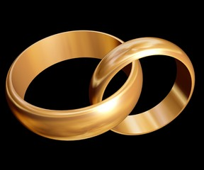 Wedding rings. Two gold rings on a dark background.
