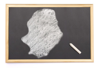 Blackboard with a chalk and the shape of Niue drawn onto. (serie