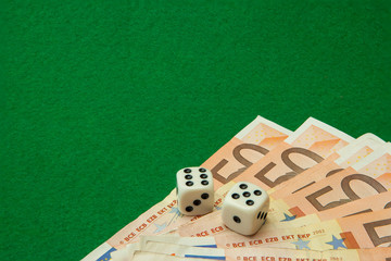 Casino green table with euro notes and dice