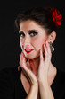 Portrait of spanish girl flamenco dancer on black