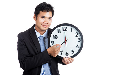 Asian office man smile hold a clock arm