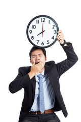 Asian office man yawn show a clock over his head