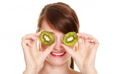 Girl covering eyes with kiwi tropical fruit
