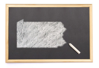 Blackboard with a chalk and the shape of Pennsylvania drawn onto
