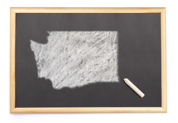 Blackboard with a chalk and the shape of Washington drawn onto.