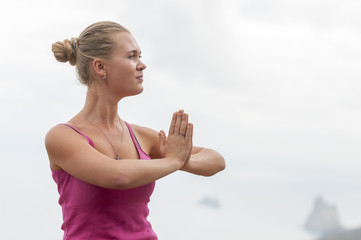 Young woman practicing yoga on the nature, Healthy Lifestyle