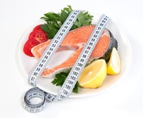 Diet weight loss concept fresh salmon steak lemon