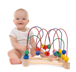 Infant child baby toddler standing and playing wooden educationa