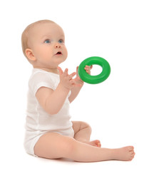Infant child baby boy toddler playing holding green circle