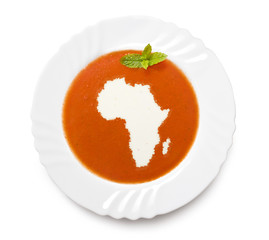 Plate tomato soup with cream in the shape of Africa.(series)