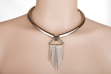 Silver statement necklace on a mannequin