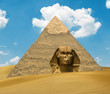 Great Pyramid of Pharaoh Khufu and the Sphinx on sand dunes - Eg