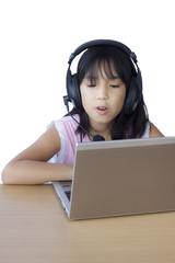 Asian young girl  playing with her laptop