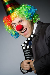 Clown with the movie board