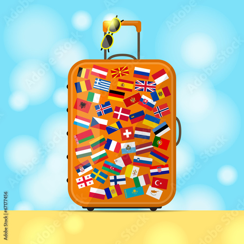 Suitcase of traveler and European flags