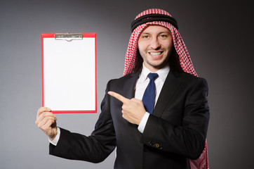 Arab man with paper binder