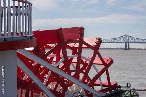 Leinwanddruck Bild New Orleans - Paddlewheel, River, and Bridge