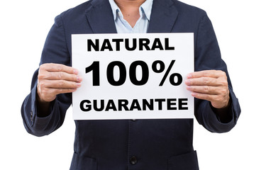 Business man hand holding paper  with natural 100% guarantee iso