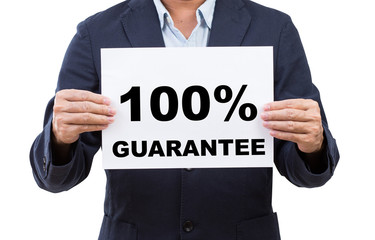 Business man hand holding paper  with 100% guarantee isolated on