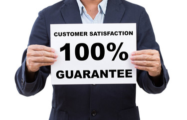 Business man hand holding paper customer satisfaction 100% guara