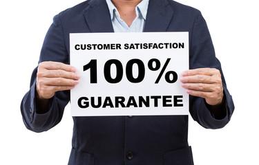 Business man hand holding paper customer satisfaction 100% guara