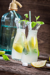 Lemon drink with mint leaf and citrus fruits