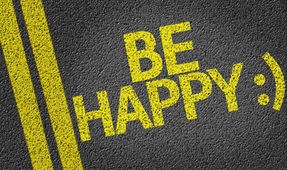 Be Happy written on the road