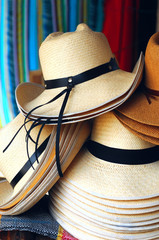 Handmade traditional Panama Hats are stacked for sale
