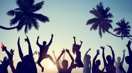Silhouettes of Young People Celebrating on a Beach