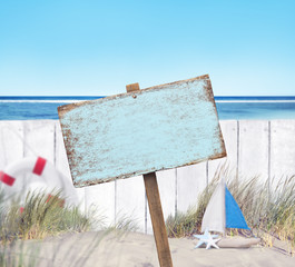 Empty Sign Board and Wooden Fence on Beach