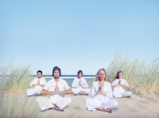 Group of People Doing Yoga on Beach