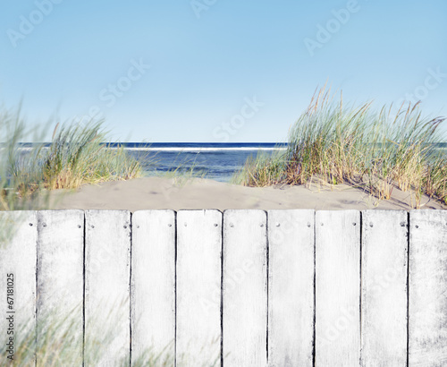 Fototapeta Beach and White Wooden Fence