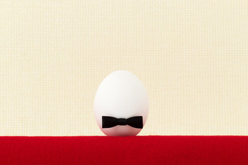 Egg with a bow on a light background