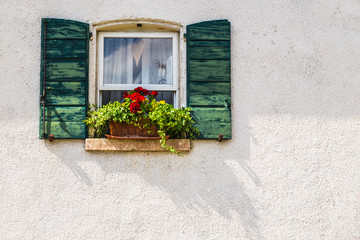 Window in an old house decorated with flower